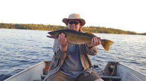 Me with a slightly larger than typical sized walleye from Lake of the Woods. Me, before loosing 100lbs!
