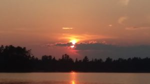Sunset from on Big Lake off the Echo Trail. Forest Fires in Canada had the air tinted with and faintly smelling of smoke.