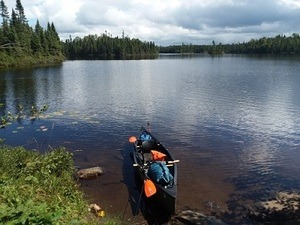 Exploring the BWCA in my Old Town Guide 119. Beautiful day somewhere on Vern Lake.